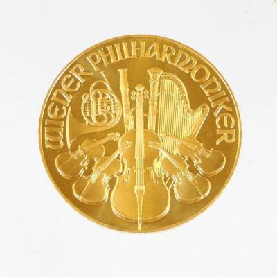A 1995 Austrian gold Philharmonic coin, marked 1 unze gold, 999.9, 2000 Schilling. - 2