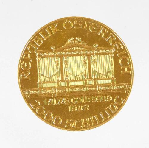 A 1993 Austrian gold Philharmonic coin, marked 1 unze gold, 999.9, 2000 Schilling.