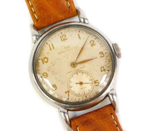 A Vintage International Watch Company stainless steel gentleman's wristwatch, with gilt Arabic hour numerals and marked IWC over *AVR* LE**A ** & ANTI-MAGNET and having subsidiary seconds dial marked INCA serial number 1091122 Hermit, on a modern brown l