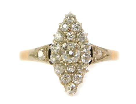 An 18ct gold diamond marquise cluster ring, set with old cut stones to the shoulders and mount, 3.1g all in.