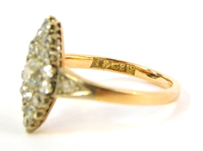 An 18ct gold diamond marquise cluster ring, set with old cut stones to the shoulders and mount, 3.1g all in. - 3