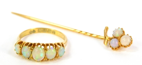 An 18ct gold dress ring set with five graduated opals, Birmingham assay, 3.3g all in and a stick pin set with three opals (2).