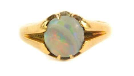 An 18ct gold dress ring, set with a single opal, Birmingham assay, 3.7g all in.