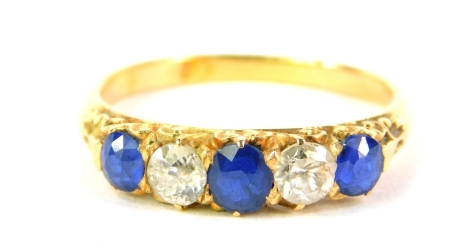 A sapphire and diamond five stone ring, set in unmarked yellow metal, 3.7g all in.