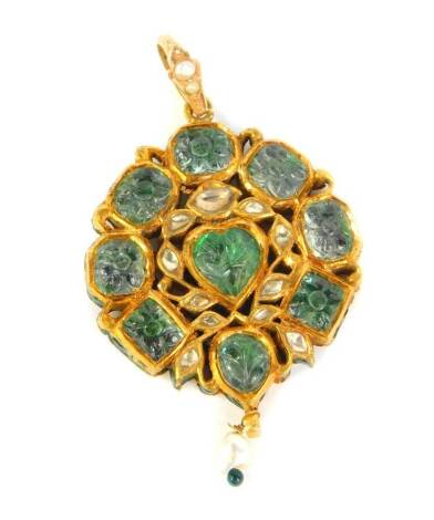 An Indian circular pendant, set with green and yellow stones and having a pearl drop, decorated verso with birds and flora in polychrome enamels, 6cm high including bale, 19.2g all in.