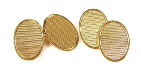 A pair of 9ct gold oval cufflinks, with engine turned decoration, 12.7g.