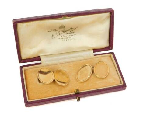 A pair of 9ct gold oval cufflinks, with Masonic emblems, 6.4g, cased.