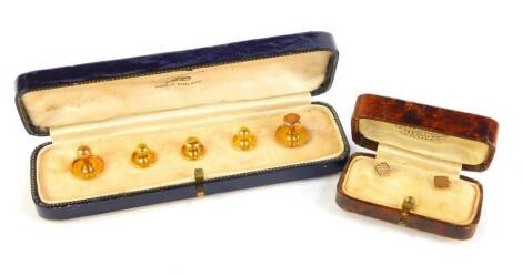 Two cased sets of shirt studs, 9ct gold, but with a single 18ct, 5.8g all in.