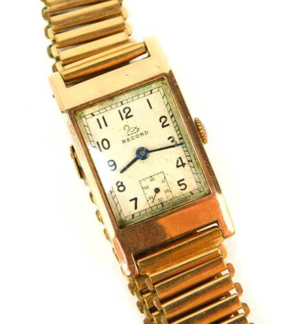A 9ct rose gold Record Art Deco tank design gentleman's wristwatch with Swiss 15 jewel movement, London 1946, on a rolled gold gate bracelet.