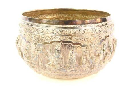 A 19thC Indian bowl, embellished with figures in relief, white metal, unmarked, 15cm diameter, 10½oz.