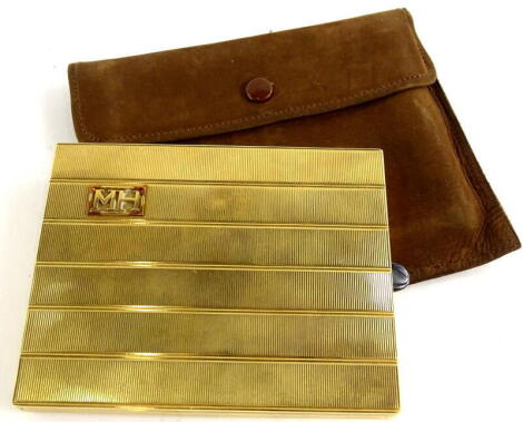 An 18ct gold cigarette case, of rectangular form, with engine turned six lined decoration, bearing the initials MH in a raised rectangle frame, with black enamel opening clasp, maker stamp G S, London, import marks for 1928, 10cm wide x 8cm high x 1cm dee