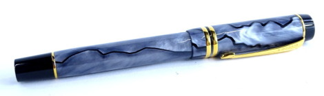 A Parker Duofold grey simulated marble and black fountain pen, with gold plated mounts, the nib stamped 18K 750.