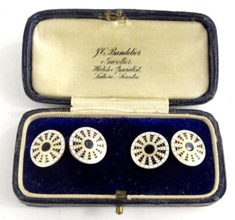 A pair of 9ct gold circular cufflinks, with black and white enamel design, markers stamp W.M & Co, boxed, 6.2g all in.
