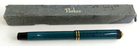 A Parker Lucky Curve lady fountain pen, in turquoise with gold plated mounts and ring top for a chatelaine, boxed.