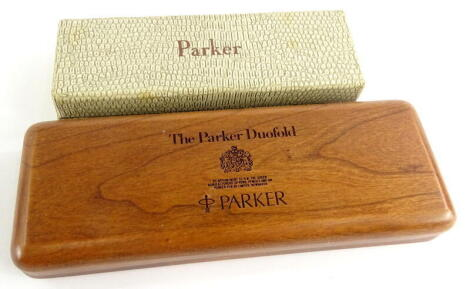 A Parker Duofold Centenary box, and another Parker box decorated to simulate reptile skin, in cream for a Parker 51 (2).