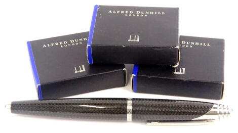 An Alfred Dunhill black carbon fibre torpedo shaped fountain pen, with brushed mounts, signed to the band, Alfred Dunhill and three boxes of Dunhill ink cartridges, possibly incomplete.