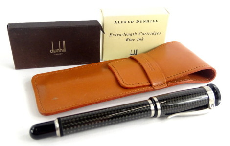 An Alfred Dunhill grey carbon fibre fountain pen, with brushed metal mounts signed to the hinged clip, and two packs of Dunhill ink cartridges, possibly incomplete, and a papyrus leather case.
