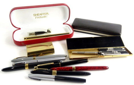 A collection of Sheaffer fountain pens, accessories, etc.
