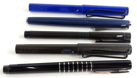 Five Lamy and various fountain pens, in shades of blue, black and grey.