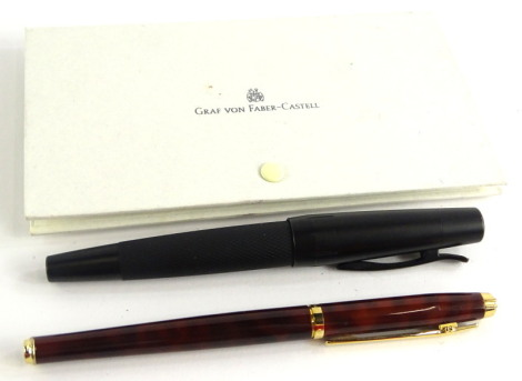 A Faber-Castell black and metal blackened steel fountain pen, with engine turned grip, and an Elysee fountain pen, etc. (2)