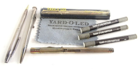 A silver Yard-O-Led fountain pen, a Yard-O-Led propelling pencil and another similar silver propelling pencil, etc.