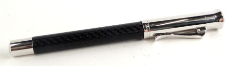 A Graf Von Faber-Castell black and silvered fountain pen, with feathered decoration, the nib stamped 18ct 750.
