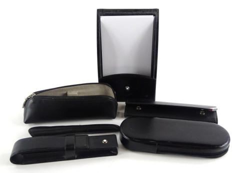 Various Montblanc leather pen cases, a leather desk paper holder, etc.
