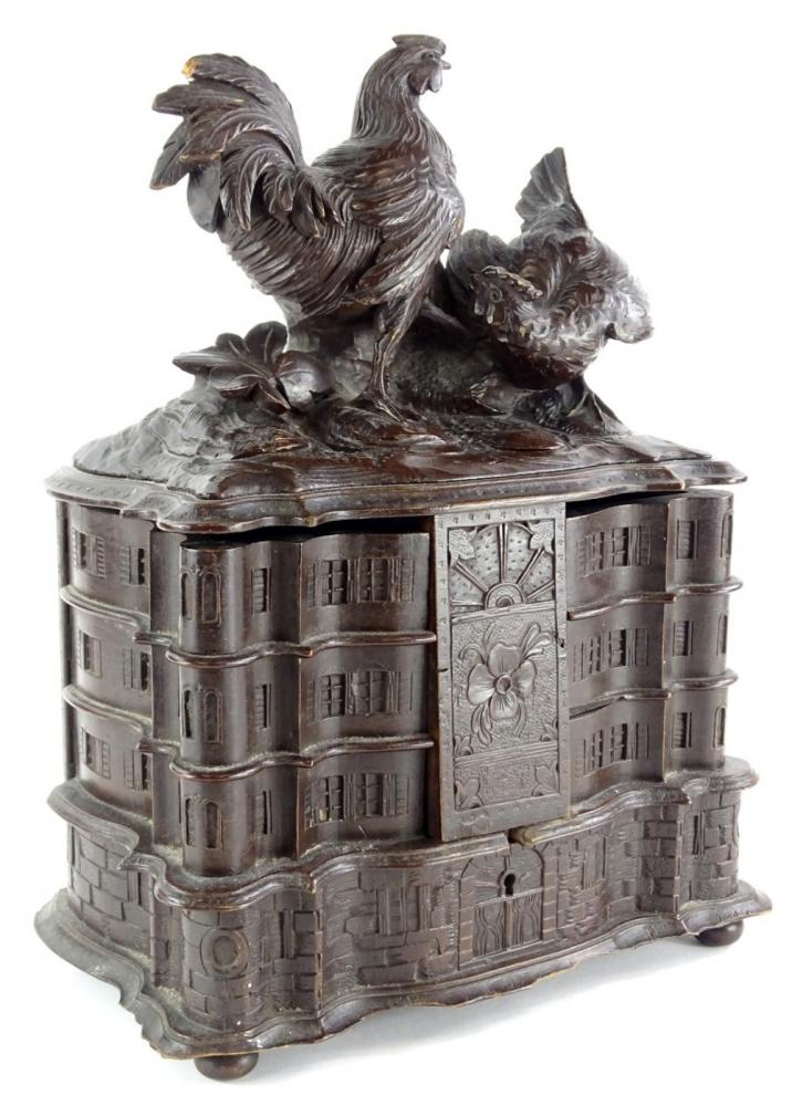 A late 19thC/early 20thC Black Forest carved jewellery box, the hinged lid...