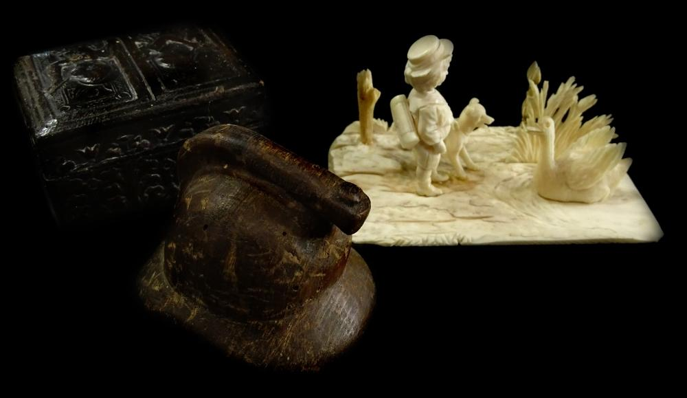 A late 19thC carved ivory figure group of a young boy, a dog and a swan, on...