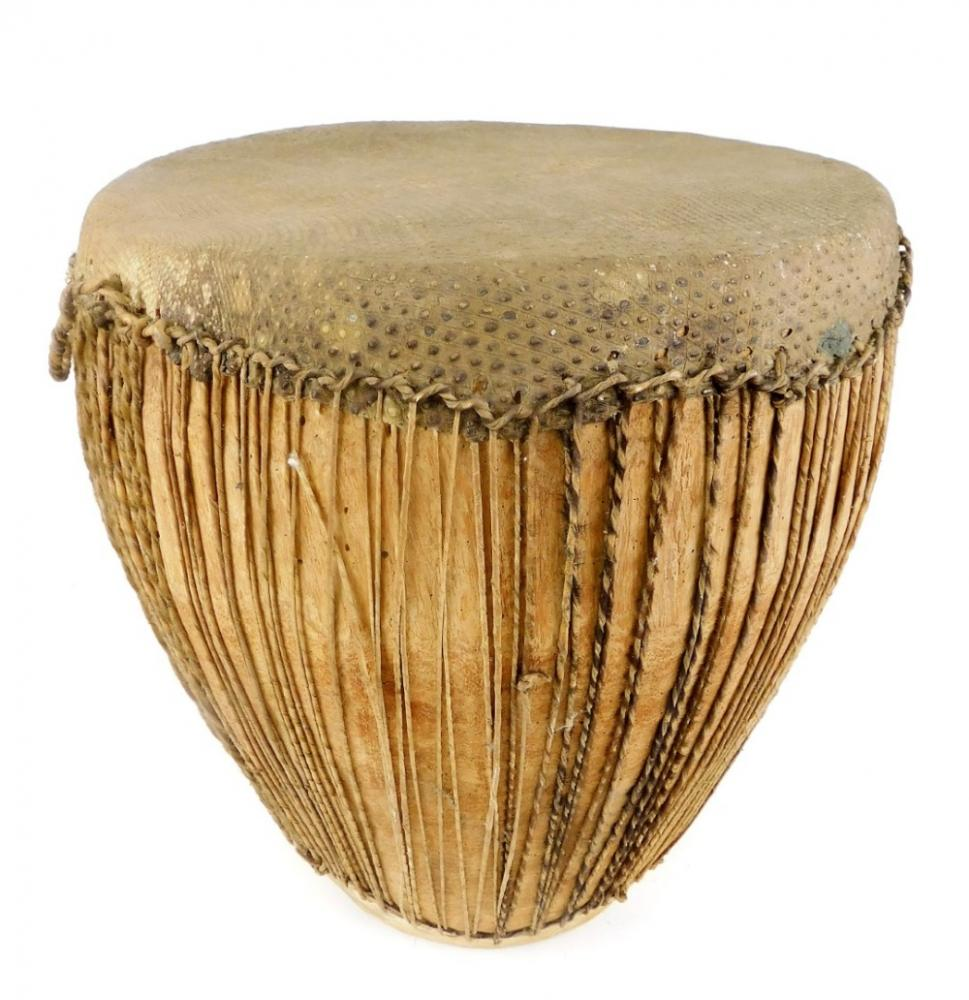 A 20thC African tribal drum, of shaped form, with strung centre on circular...