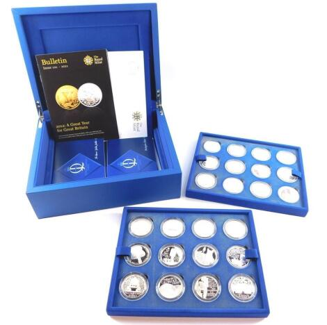 A Royal Mint The Queen's Diamond Jubilee Coin Collection, containing twenty four silver proof crowns, with certificates, cased and outer boxed.