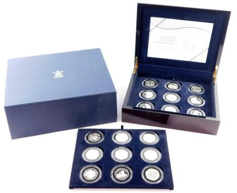 A Royal Mint Diamond Wedding Anniversary Silver Proof Coin Collection, H M The Queen and HRH Prince Philip, eighteen crowns in two trays, cased and boxed, with certificate.