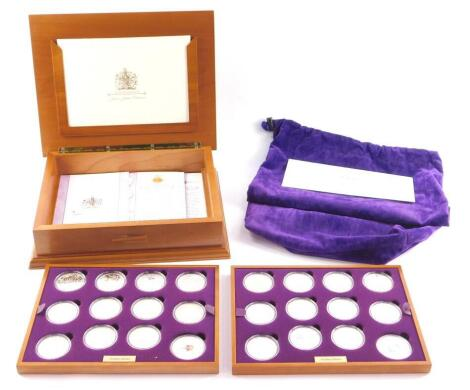 A Royal Mint Queen Elizabeth II Golden Jubilee Collection, twenty four coins in two trays, boxed with protective bag, with certificate.