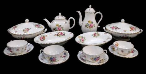 A group of Royal Worcester porcelain decorated in the Roanoke pattern, Z2827, comprising of a pair of vegetable tureens and covers, pair of oval serving dishes, four soup cups and saucers, teapot and coffee pot.