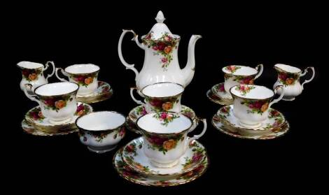 A Royal Albert porcelain part tea and coffee service, decorated in the Old Country Roses pattern, some seconds, comprising coffee pot, two cream jugs, sugar bowl, six teacups and saucers, and six tea plates.