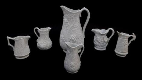 Six Portmeirion Heritage Collection parian relief moulded jugs, printed and raised marks, 9-, 22cm high.