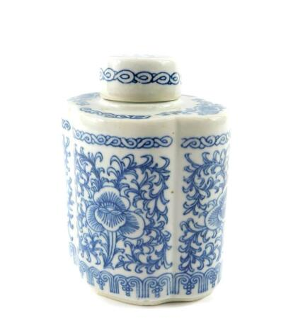 A Chinese blue and white porcelain tea canister and cover, of lobed form, decorated with flowers and scrolling leaves, bears six character mark, 16.5cm high.