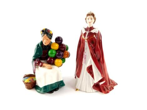 A Royal Doulton figure modelled as The Old Balloon Seller HN1315, together with a Royal Worcester porcelain figure of Her Majesty The Queen, in celebration of The Queens 80th Birthday 2006, dressed in the robes of the Order of the British Empire. (2)