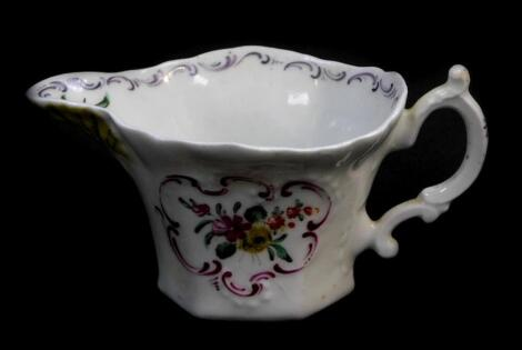 A First Period Worcester polychrome porcelain cream boat, of moulded hexagonal form with C-scroll handle, hand painted with sprigs of flowers in puce reserves, the spout highlighted in yellow and modelled as a shell, unmarked, c.1756/58, 10.5cm wide.