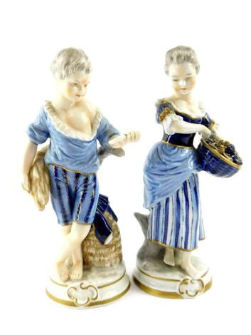 A pair of Unterweissbach 20thC porcelain figures, of a boy and girl, modelled standing with a sheath of corn and basket of grapes respectively, raised on circular bases, printed mark, 21cm high.