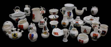 Goss and Crested china, including the old horse shoe, arms of Blandford Forum, lobster trap Arms of Jersey, two shell shaped dished Arms of Colchester and Wolverton, ancient jar found in the abbey ruins at Wymondham, ancient arms of Bedford and an abbot's