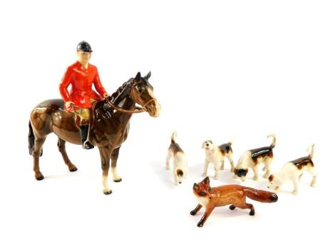 A Beswick pottery figure of a huntsman on a brown gloss horse, together with four hounds and a fox. (AF, 6)