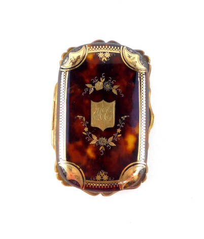 A Victorian tortoiseshell purse, with gold and silver pique decoration, decorated centrally with a monogrammed shield in a surround of flowers, 8.5cm wide.
