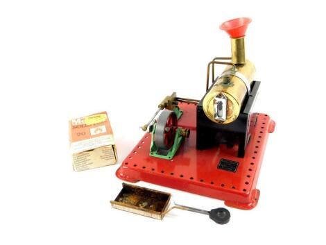 A Mamod steam engine, with solid fuel tablet box and funnel.
