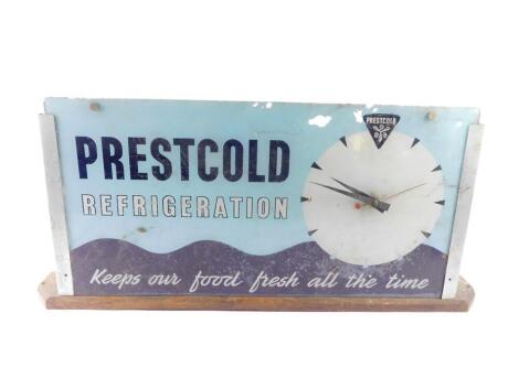 A mid 20thC Prestcold Refrigeration glass advertising clock, of rectangular section, with a circular dial against a turquoise and black wavy ground 'Prestcold Refrigeration, Keeps Our Food Fresh All The Time'., electric movement, on an oak base, 35.5cm hi