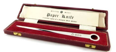 A silver paper knife, being a faithful replica of the Georgian meat skewer, cased, Sheffield 1969, 1.93oz.
