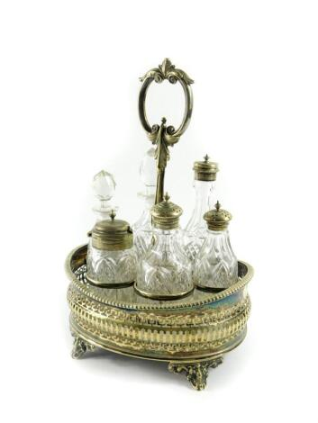 A Victorian silver plated and cut glass six bottle cruet on stand, 30cm high.