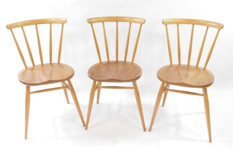 A set of three Ercol blonde elm and beech single dining chairs.