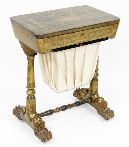 A 19thC Chinese export black lacquer work table, with rounded rectangular chinoiserie decorated hinged top enclosing a fitted interior with various ivory and bone implements, compartments with shaped ivory lids, etc on turned legs joined by a cylindrical