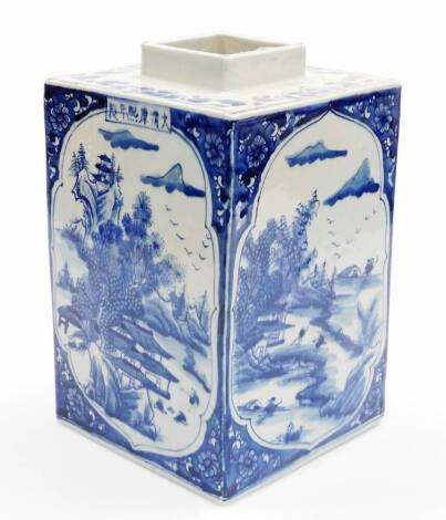 A Chinese porcelain blue and white porcelain tea canister, of rectangular form, decorated with shaped panels of figures, buildings, trees and mountains, with floral spandrels, six character Kangxi mark to one side, probably 20thC, 28cm high.